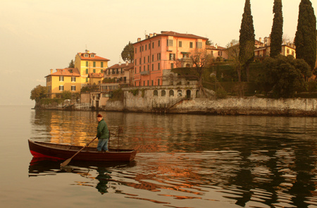 A fisherman heads out at dawn from Verenna on Lake Como in Northern Italy : Travel World : Michael Ventura Photography, Washington DC, Portraits, Stock, Caribbean, Headshots, head, shots , Photographer, Photography