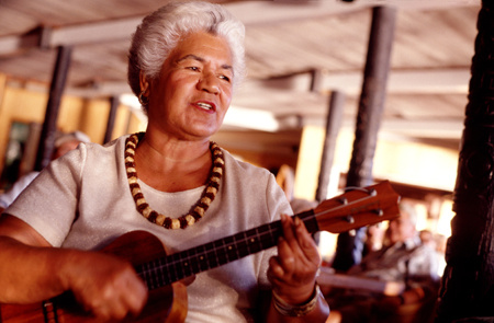 A woman strums a ukelele on Molokai, Hawaii : Travel USA : Michael Ventura Photography, Washington DC, Portraits, Stock, Caribbean, Headshots, head, shots , Photographer, Photography